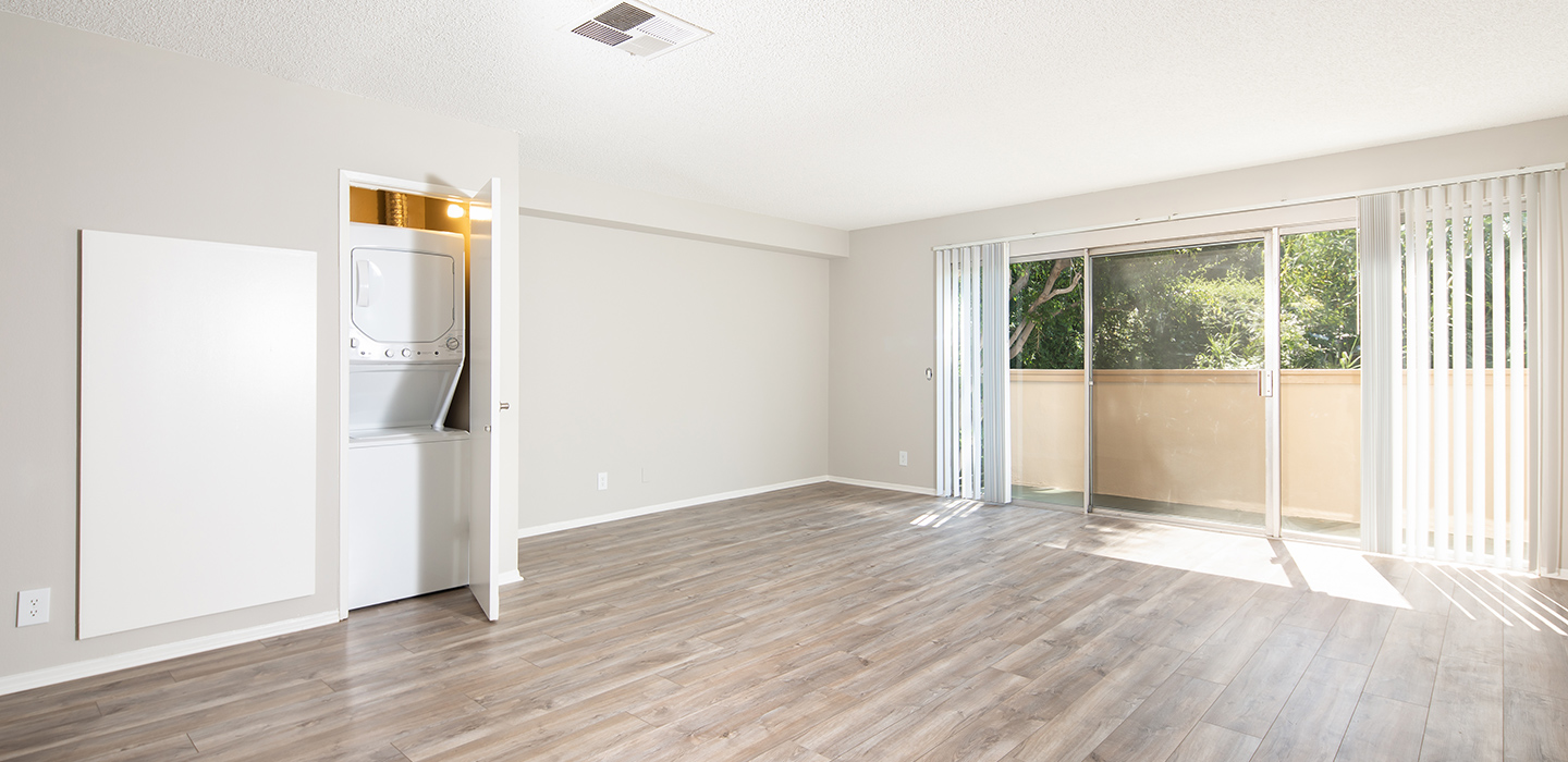 living room with washer and dryer